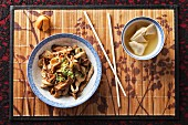 Chinese pork and mushrooms with a bowl of wonton soup