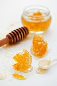 Honey and honeycomb with a honey spoon