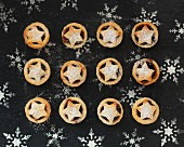 Mini mince pies topped with a star and dusted with icing sugar