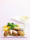 Crab cakes with vegetables and aioli