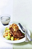 Grilled lamb steak with honeyed onions