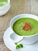 Cream of pea soup with chilli threads