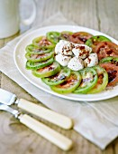 A tomato salad with balsamic vinegar and mozzarella