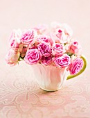 Posy of roses in teacup