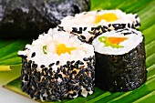Maki sushi with sesame seeds