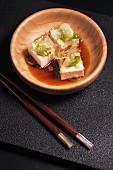 Hiyayakko (cold silk tofu, Japan) with bonito flakes, chives, grated ginger and soy sauce