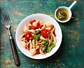 Shell pasta with tomatoes, capers and basil