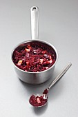 Apple-red cabbage in a pan and on a spoon