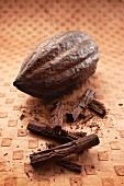 A cacao fruit and chocolate flake