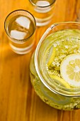 Elderflower juice with lemon in a glass jug and in glasses