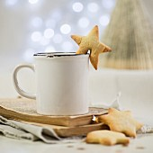 A cup of hot chocolate and star shaped sables for Christmas