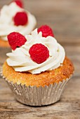Cupcakes decorated with buttercream and raspberries