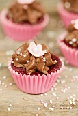Chocolate cupcakes decorated with sugar peals and sugar flowers