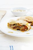 Vegetable strudel with sauce