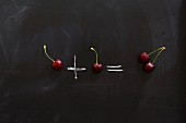 One Cherry plus one cherry equals a pair of cherries