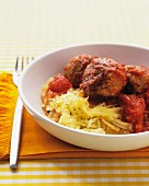 Chicken meatballs in tomato sauce on pumpkin spaghetti