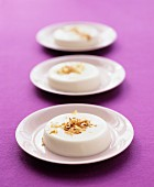Coconut puddings with roasted grated coconut