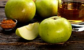 Bramley apples, ale and curry powder (ingredients for apple and curry chutney with ale)