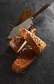 Three slices of chocolate orange cake with cake slice