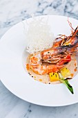 King prawns in red curry sauce with fried rice noodles