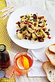 Marinated artichokes, white bread and Campari soda (Italy)