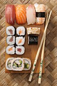 Various types of sushi on a wooden board