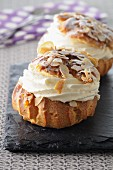 Profiteroles with cream and slivered almonds