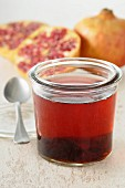Pomegranate jelly and fresh pomegranates