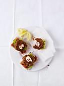 Crisp bread topped with mini meatballs