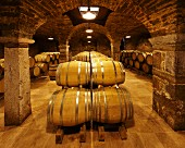 Barrel ageing in the 12th-century Cistercian cellars of Domaine de la Tournelle, Arbois, Jura, France