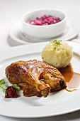 Duck with potato dumplings and red cabbage