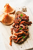 Fried red pine mushrooms with caraway on a slice of country bread