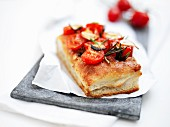 Focaccia topped with tomatoes and rosemary