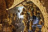 Culatelli di Zibello ageing in cellar of Antica Corte Pallavicina. Polesine Parmense, Emilia-Romagna, Italy.