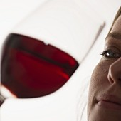 Woman tasting Bordeaux wine.