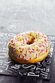 An iced doughnut with sugar sprinkles