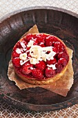 A raspberry tartlet topped with white chocolate