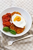 Carrot fritter with a fried egg and braised tomatoes