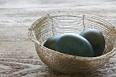 Dyed Easter eggs in a basket