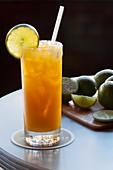 Orange juice-based cocktail garnished with lime