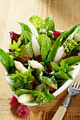 Wild herb salad with asparagus and raspberries