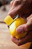 A lemon being peeled