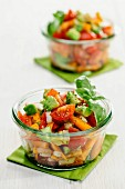 Summery vegetable salads with tomatoes, avocado and carrots