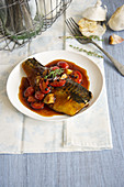 Mackerel fillet in tomato sauce with garlic and thyme