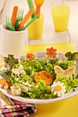 Mixed leaf salad with flower-shaped croutons and butterflies