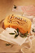 A loaf of bread for a Christening decorated with a name