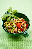 Bean and sweetcorn salad with tomatoes and spring onions