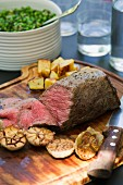 Roast beef with garlic, potatoes and peas