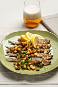 Fried herring with croutons, parsley, lemon and beer