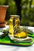 Two jars of rosemary honey on a garden table